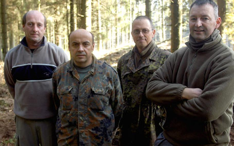 """Some people refer to this band of Belgians as """"The Diggers"""" for its dogged determination to recover the remains of U.S. infantrymen who remain missing from the Battle of the Bulge. Pictured from left to right are: Jean-Luc Menestrey, Marc Marique, Jean-Philippe Speder and Jean-Louis Seel."""