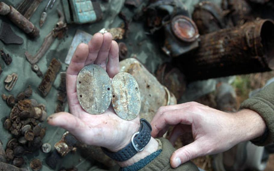 """Two sets of """"dog tags"""" belonging to a pair of German soldiers from World War II were unearthed earlier this month along the German-Belgian border. Along with the tags, four Belgian men found other personal effects as well as the soldiers' remains. The Belgian men, known by some people as """"The Diggers,"""" have spent more than 20 years scouring the woods and hills of southeastern Belgium looking, primarily, for the remains of U.S. soldiers. To date, they have found the remains of 12 Americans and six Germans."""