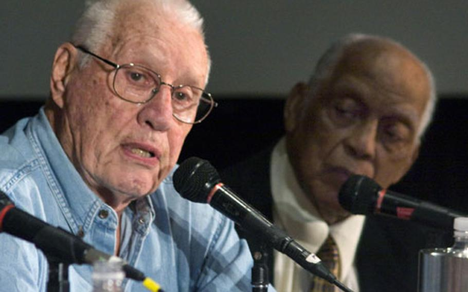 Baseball Hall of Famers Bob Feller, left, and Monte Irvin at a panel discussion on Baseball and World War II at the American Veterans Center's annual conference.