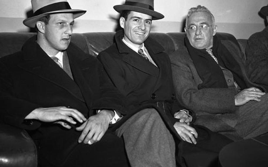 Frankfurt, Germany, February 4, 1951: Four of the baseball notables taking part in the week-long EUCOM Baseball and Softball Coaches and Officials clinic relax at Rhein-Main airport after a 27-hour flight from the States. From left to right are players Stan Musial of the St. Louis Cardinals and Jerry Coleman of the New York Yankees; and former Giants and Cardinals great Frankie Frisch.