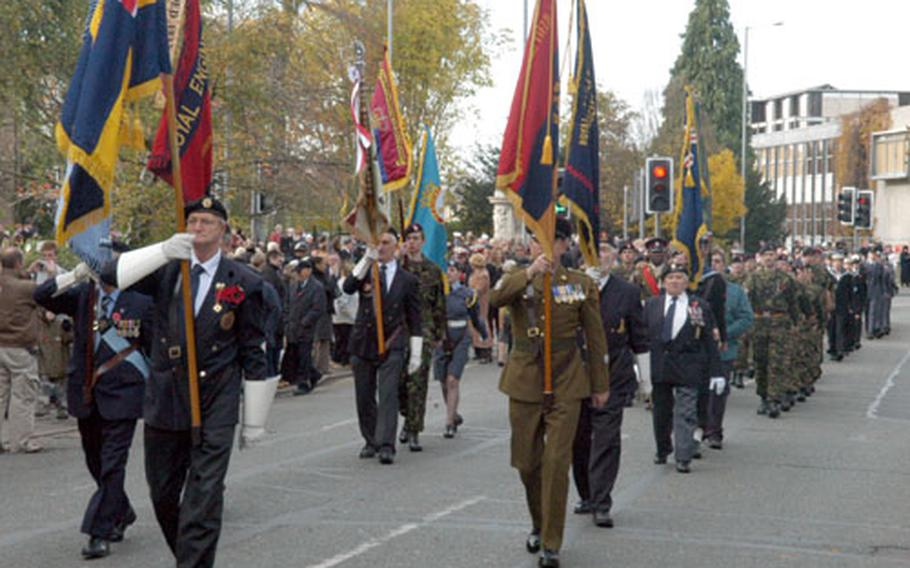 Veterans and current troops march down Station Road in Cambridge during a Remembrance Day ceremony.