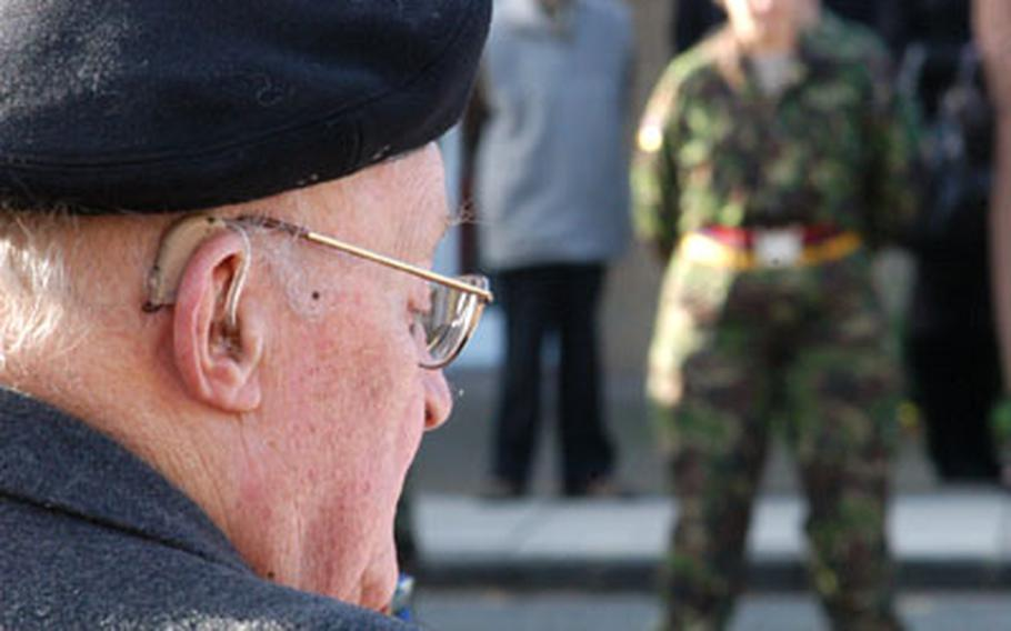 A British war veteran bows his head during a prayer at a Remembrance Day memorial in Cambridge.