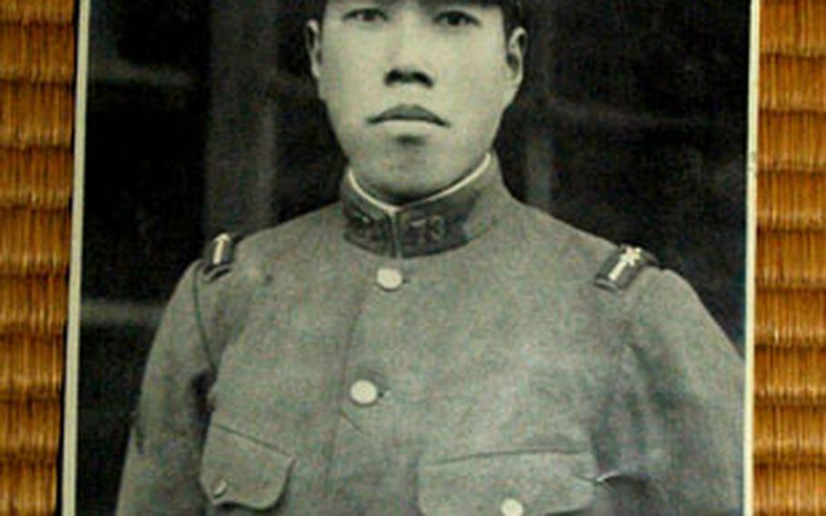 A photograph of Minoru Uchino, a Japanese soldier who died during World War II. A flag once owned by him was returned to his family during a ceremony Monday.