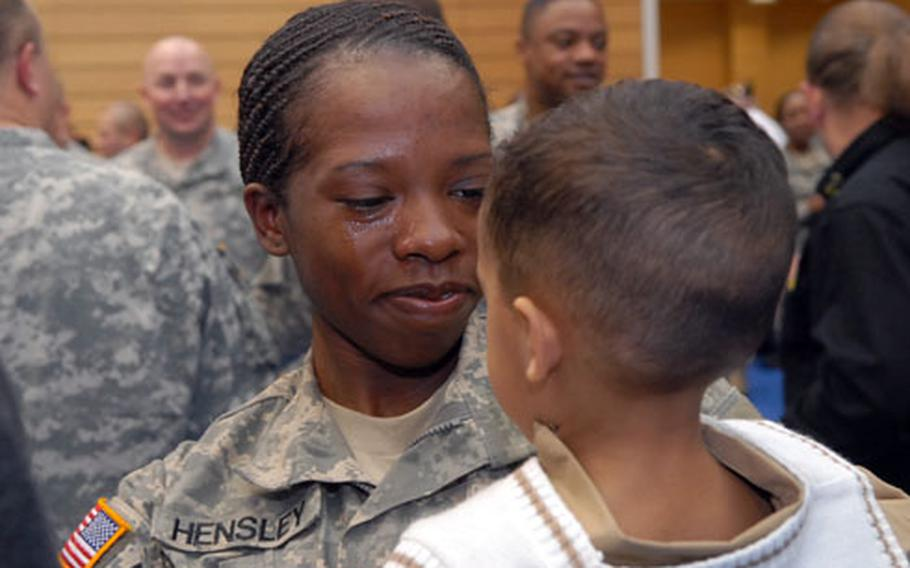 A teary-eyed Spc. Calandra Hensley gets a good look at her son Joseph, 1, after their reunion at Wiesbaden Army Airfield. Fifty-two 1st Armored Division soldiers arrived from their Iraq deployment Wednesday.