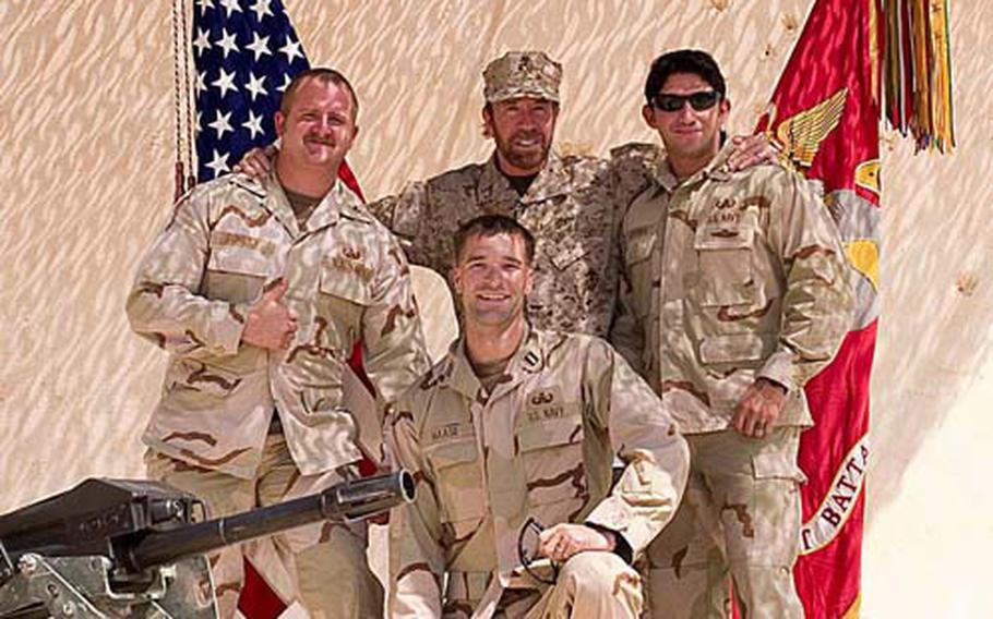 Lt. Jonathan Haase, bottom center, and his explosive ordnance disposal teammates Petty Officer 1st Class Deakin Donley, far left, and Petty Officer 2nd Class Joe Guerra, far right, meet actor and martial artist Chuck Norris in Iraq in 2007.