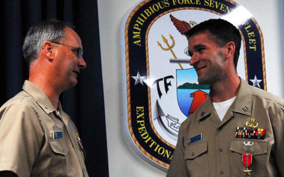 Lt. Jonathan Haase talks with Rear Admiral Richard Landolt after being awarded the Bronze Star with valor device for his service in Iraq.