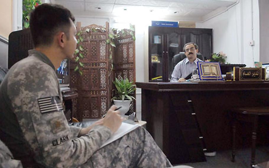 Maj. Tom Clark, head of the 1st Brigade Combat Team, 4th Infantry Division's infrastructure coordination team, talks about Baghdad projects with Salah Mehdi Mohammad, director general of the Rashid Beladiya. U.S. advisers have been working with local leaders like this public works manager to prepare them for the day when the Iraqis must stand on their own.