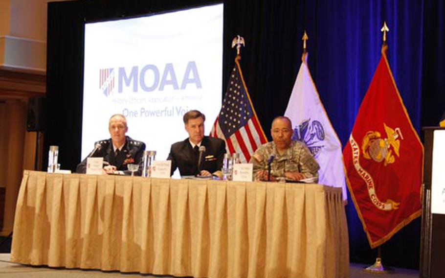 From left: Lt. Gen. Richard Newton III, Air Force deputy chief of staff for personnel; Vice Adm. Mark Ferguson III, chief of Naval Personnel; and Lt. Gen. Michael Rochelle, Army deputy chief of staff for personnel, discuss budget constraints on benefits and weapons programs at the Military Officers Association of America's annual symposium on Monday.