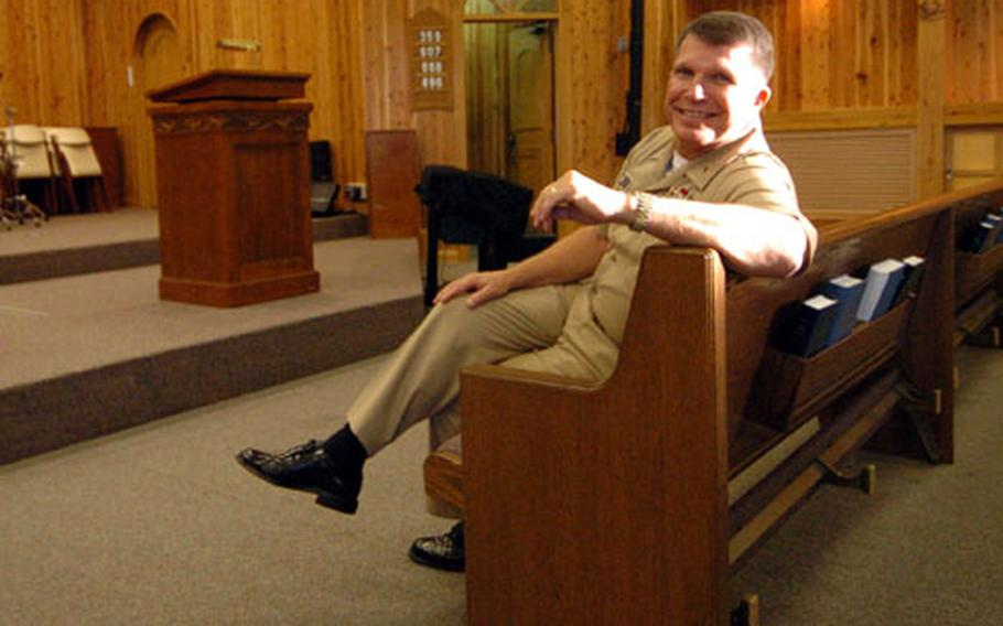 Chief of Navy Chaplains Rear Adm. Robert F. Burt sits inside the Naval Air Facility Atsugi chapel Tuesday. Burt spoke with Stars and Stripes about current issues that chaplains are helping servicemembers face and how chaplains facilitate different faith groups.