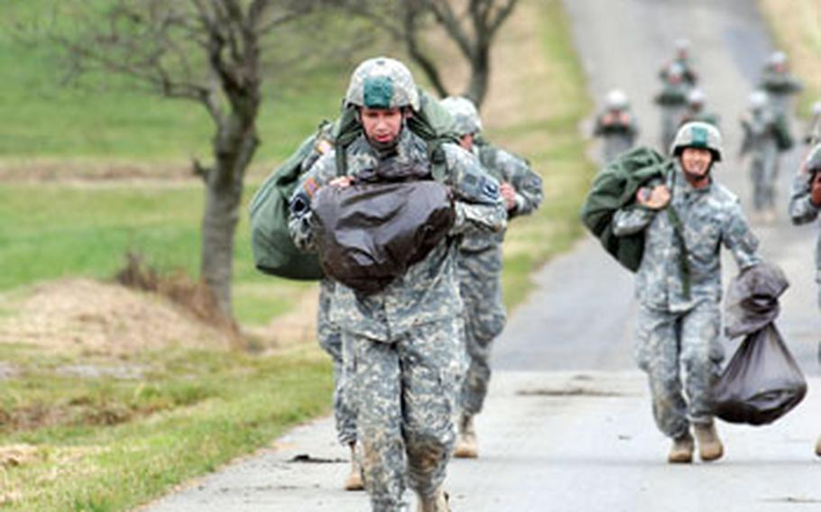 173rd Airborne soldiers carry their gear to a rally point after parachuting into fields near Ehenfeld, Germany, on Wednesday.