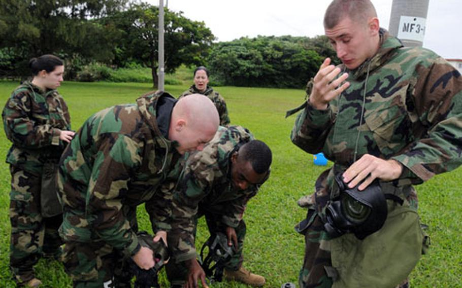 Cpl. Anthony Bartholomaus, right, 21, from Sioux City, Iowa, and other Marines try to shake off the effects of tear gas after a visit to Futenma's gas chamber.