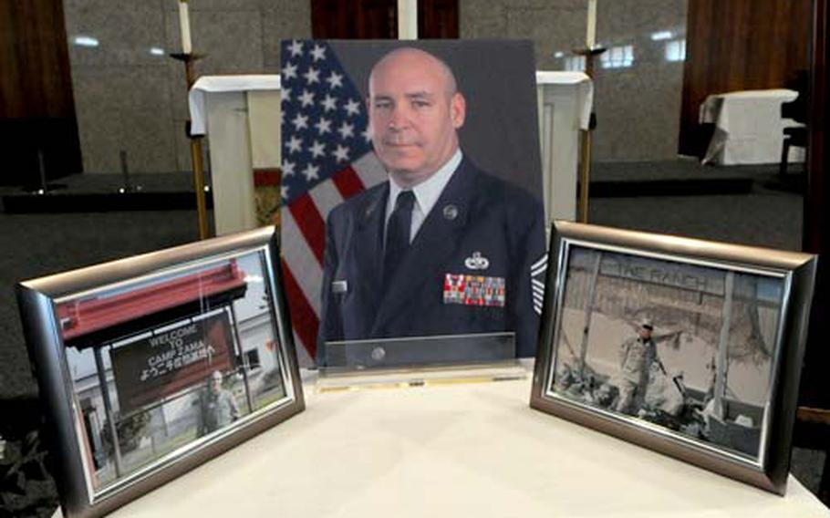 A display of photos of Senior Master Sgt. James G. Strong was part of his memorial service at the Yokota Air Base, Japan, chapel on Thursday.