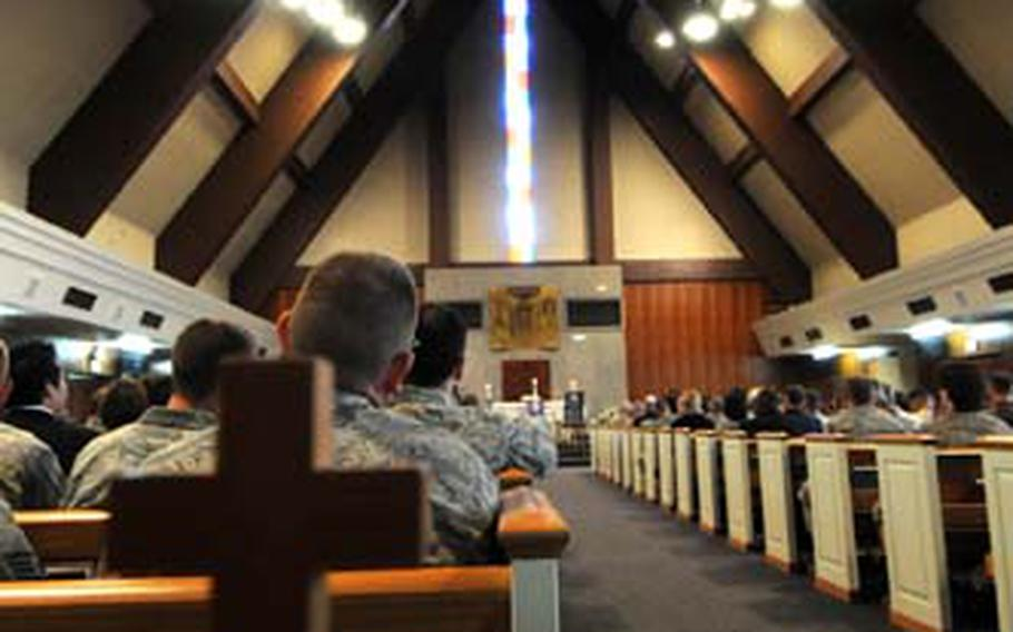 Mourners filled the Yokota Base Chapel.
