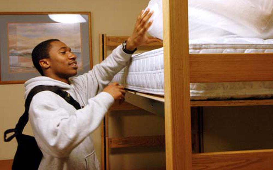 Petty Officer 3rd Class Bobby Rogers sizes up his rack in his new barracks room Saturday at Yokosuka Naval Base, Japan.