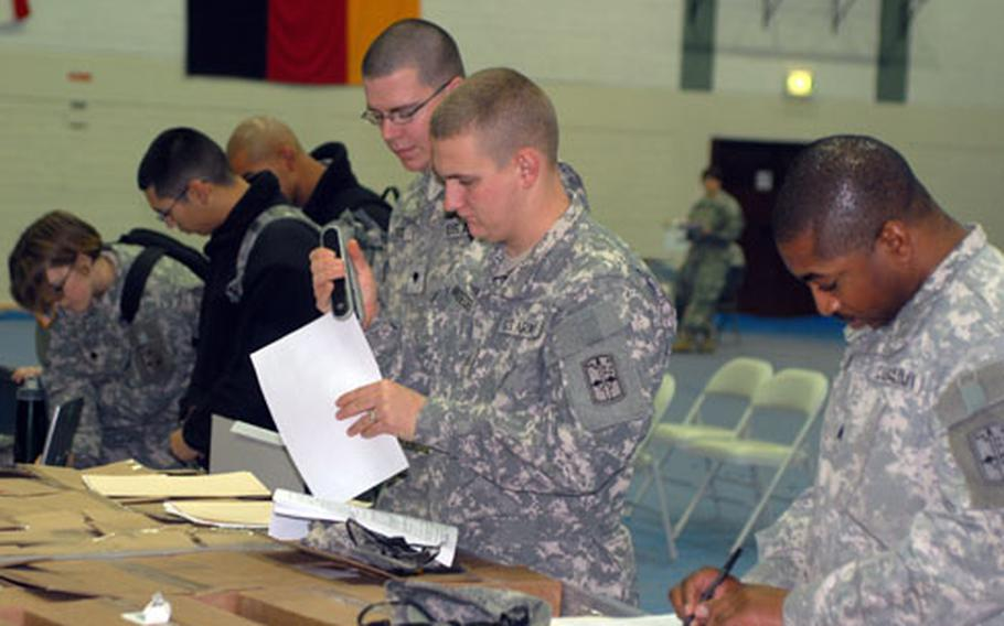 Soldiers headed to Iraq take care of last-minute paperwork at the Grafenwöhr Field House on Thursday.