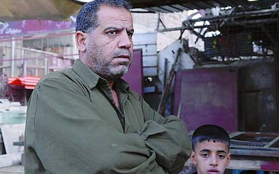 Many residents, like blacksmith Razaq Jabar, left, also blame them for making traffic unbearable and hurting businesses.