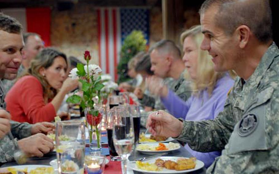 On Sunday, 2nd Stryker Cavalry Regiment leaders Maj. Steven Soika, left, and Lt. Col. Omar Jones enjoy a welcome home meal at Dagstein castle, courtesy of the city of Vilseck, Germany.