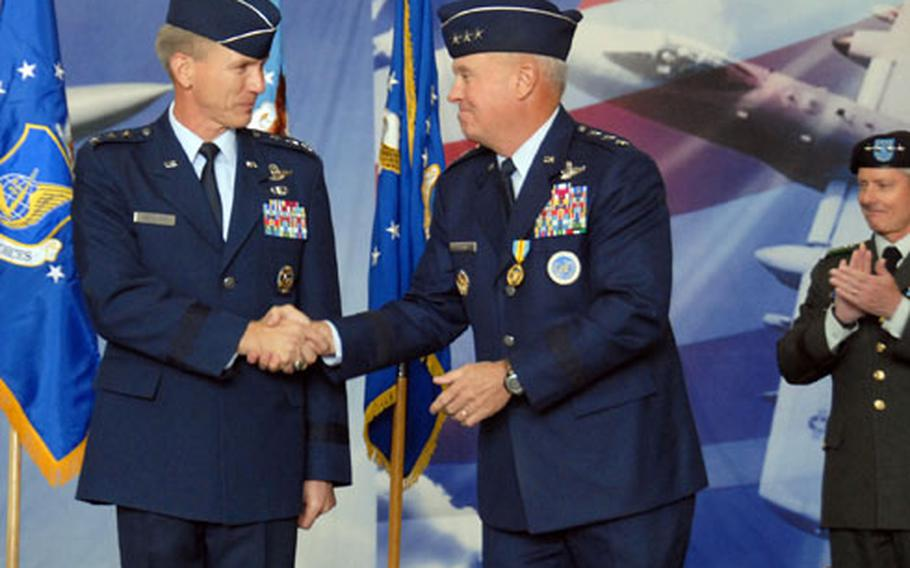 New 7th Air Force commander Lt. Gen. Jeffrey Remington, left, shakes hands with outgoing commander Lt. Gen. Stephen Wood during a change of command ceremony Monday at Osan Air Base.