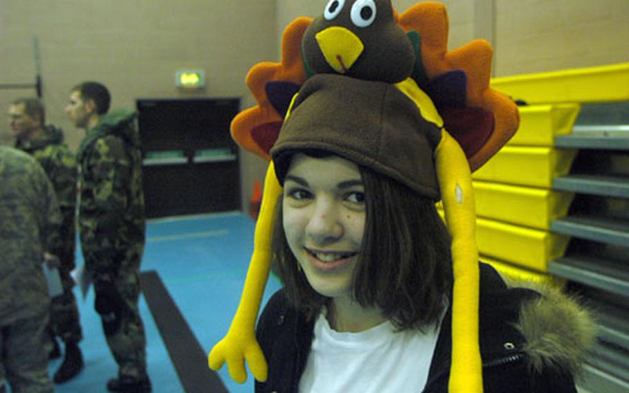 Becki Wright, an eighth-grader, volunteered to direct foot traffic during the Turkey Trot.