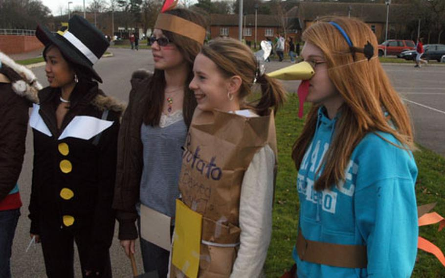 From left, Jessica Bermudez, Elisabeth Rhea, Shelby Vondenstein and Marissa Parnminter, all eighth-graders at Lakenheath Middle School, line up Friday to run the school's first Turkey Trot. Boy's and girl's winners from each grade won a turkey for Thanksgiving.