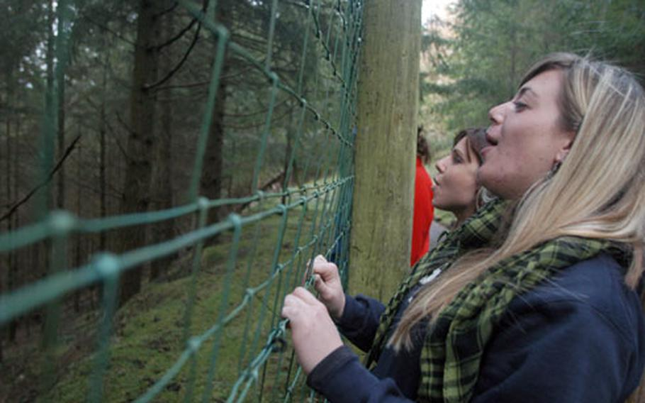 Tara Dixon, foreground, and Jacy Gleaves, background, howl down into the valley during a visit to the Wolf Watch U.K. center in Shropshire, near the Welsh border. Mildenhall Outdoor Recreation has a relationship with the private, nonprofit wolf sanctuary and hosts trips there throughout the year.