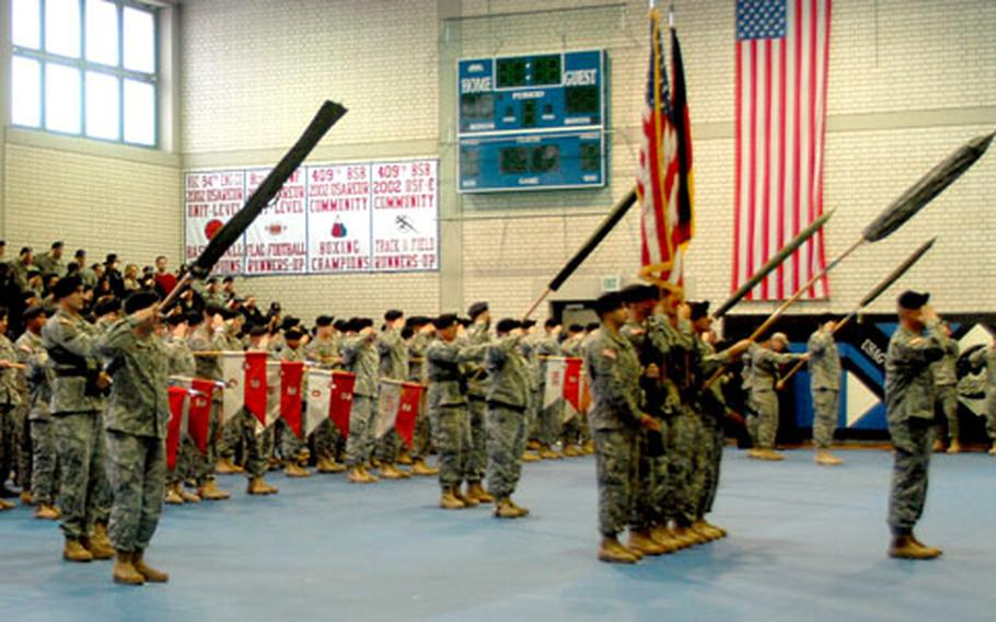 Dragoons stand ready to uncase the colors during a ceremony to welcome home members of the 2nd Stryker Cavalry Regiment at Vilseck on Tuesday.