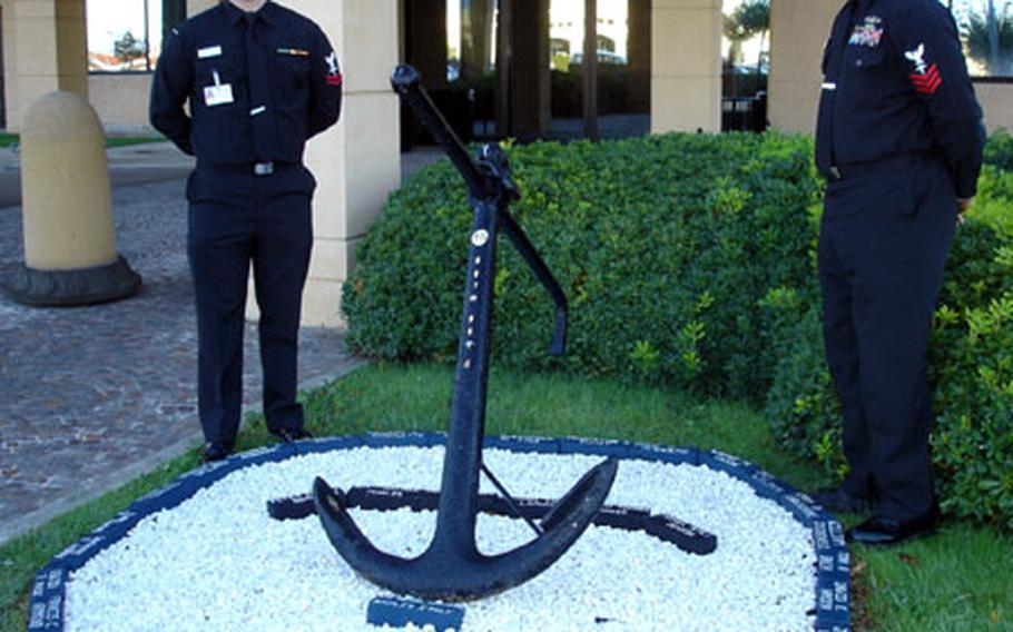 Petty Officer 2nd Class Andrew Hoysock, left, and Petty Officer 1st Class Byron Thompson Sr. created a memorial garden at the entrance of U.S. Naval Hospital Naples to honor Naval medical community Medal of Honor recipients and Navy medical personnel listed as missing in action in past conflicts.