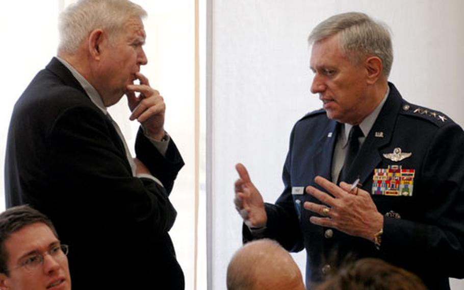 Rep. John Murtha, D-Pa., left, talks with U.S. Air Forces in Europe commander Gen. Roger Brady at Landstuhl Regional Medical Center on Thursday.