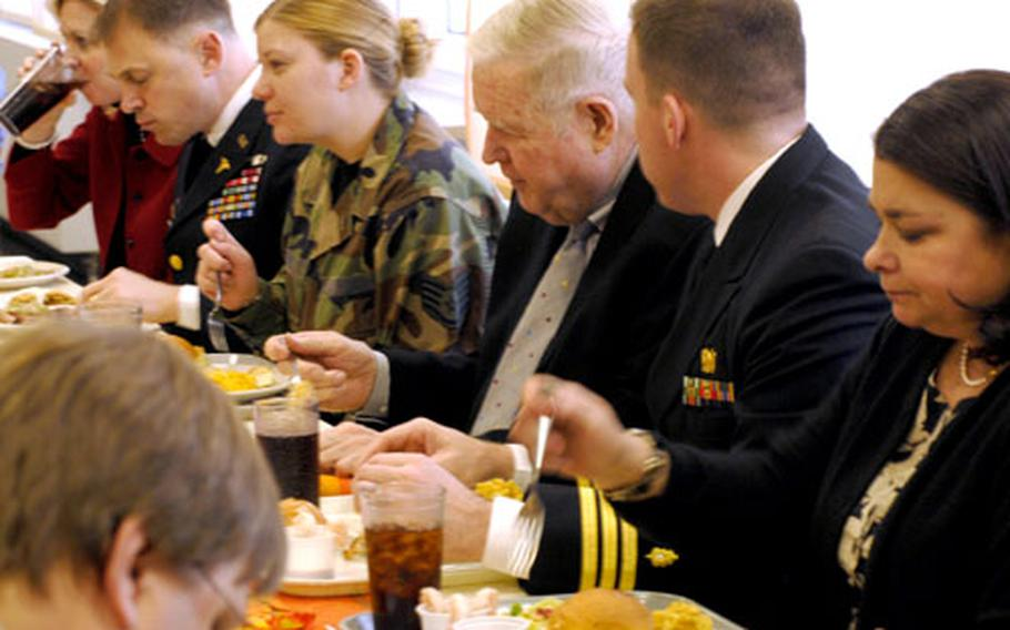 Rep. John Murtha, D-Pa., center, enjoys Thanksgiving dinner at Landstuhl Regional Medical Center with Navy Cmdr. Fred Lindsay, on Murtha's left, and Air Force Staff Sgt. Margaret Hill, on Murtha's right. Near the far end of the table is Landstuhl commander Army Col. Brian Lein. Also at the table were U.S. Army Europe commander Gen. Carter Ham and Europe Regional Medical Command commander Brig. Gen. Keith Gallagher.
