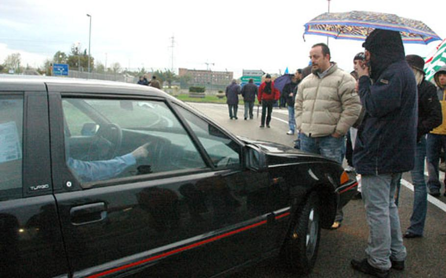 For the most part, Friday's strike at the front and back gates of the U.S. Navy's support site base by Italian employees was civil, with infrequent pockets of tension between protestors and motorists who sought to enter the base and protestors who stood in front of cars to blocking passage.