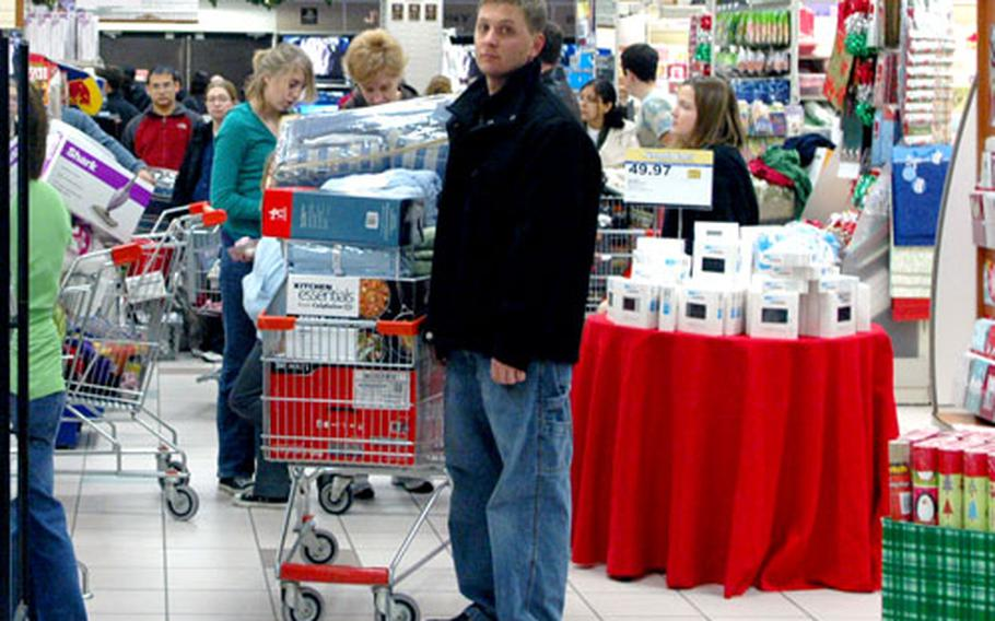 Shoppers flocked to the Navy Exchange at the support site base in Gricignano early Friday morning despite a strike by Italian workers. The NEX opened two hours earlier than normal for one of its busiest holiday shopping days.