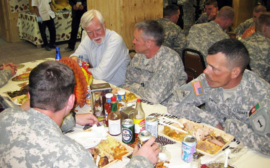 Undersecretary of the Army Nelson Ford, left, eats a Thanksgiving meal with soldiers with an Afghan Army Embedded Training Team working out of Gardez in eastern Afghanistan.