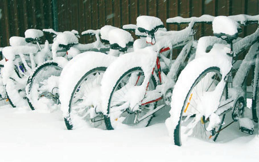 Snow piled up on a row of bicycles parked at Smith Barracks in Baumholder.