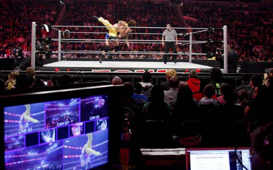 The World Wrestling Entertainment production crew monitors camera angles at the Verizon Center on December 1.