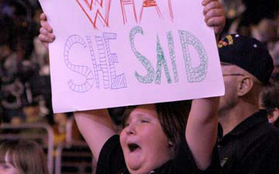 Casey Shingler cheers at the Dec. 1 RAW show at the Verizon Center. Shingler's father, Army Maj. Louis Dorfman, received free tickets through the Wounded Warriors program.