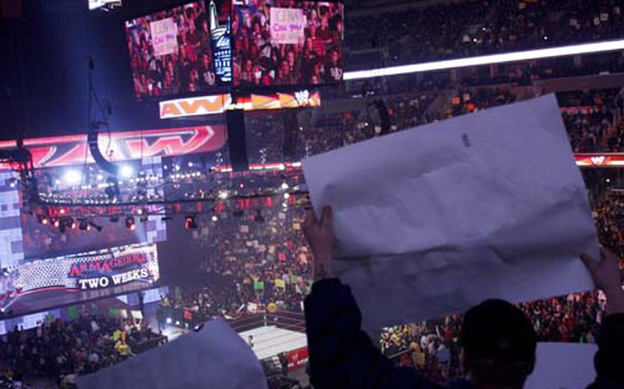 Fans wave signs during a commercial break.