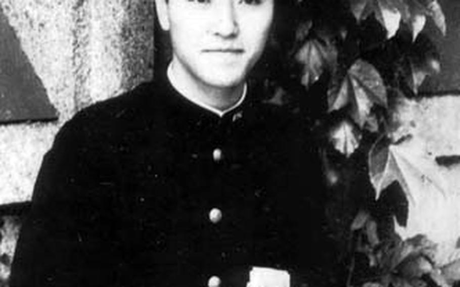 Kiyoshi Ogawa poses for a picture in his school uniform. The Kamikaze pilots were recruited from a group of gifted students.