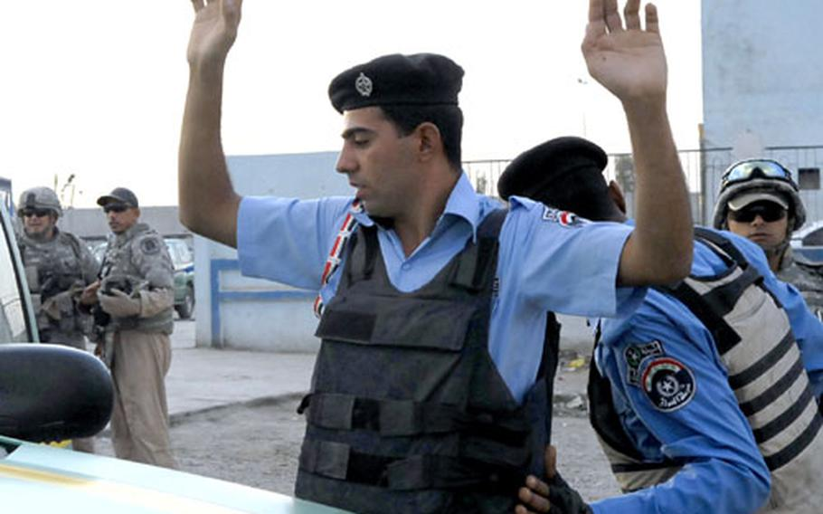 Baghdad police officers practice a vehicle stop after a lesson from U.S. police trainers. U.S. troops say officers in the capital still need to learn the basics of police work.