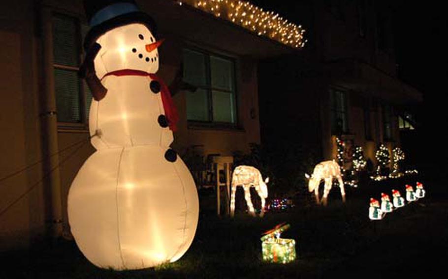 Christmas decorations glow brightly outside a home at Yokota Air Base, Japan.