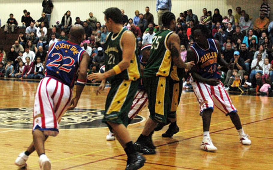 Harlem Globetrotters trap members of the Washington Generals in their trademark figure-eight offense during a game Friday night in the Samurai Fitness Center at Yokota Air Base, Japan. The Globetrotters visited Yokota as part of their holiday tour of military bases throughout the Pacific.