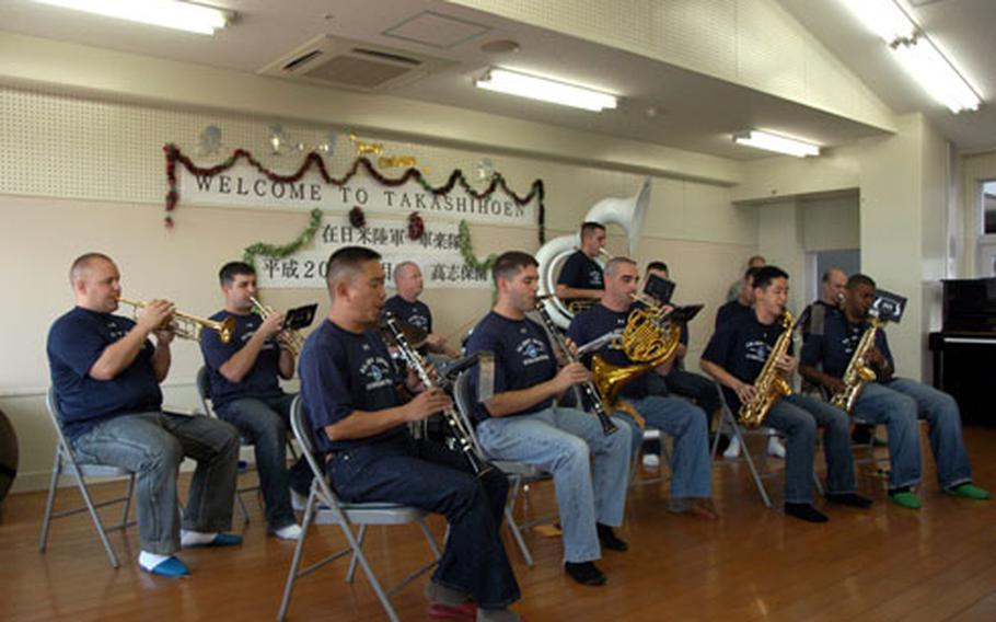Members of the U.S. Army Japan Band from Camp Zama perform Monday at the Takashihoen facility for developmentally disabled adults in Yomitan Village on Okinawa.