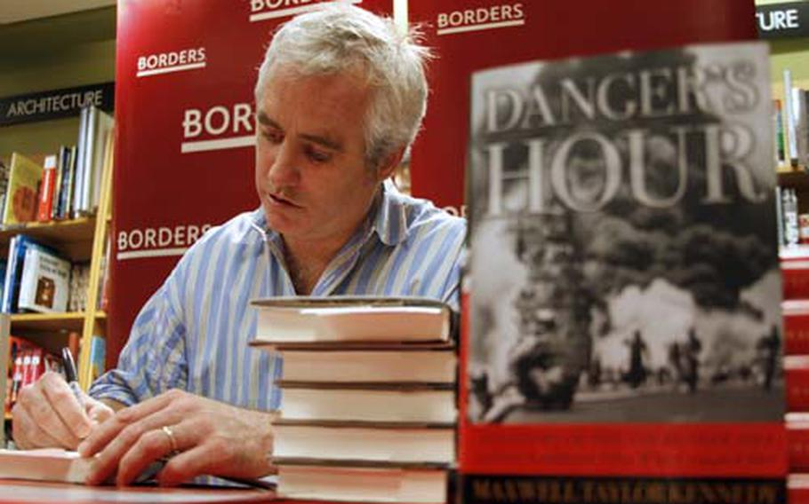 Max Kennedy signs copies of his book, Danger's Hour. Kennedy is the youngest son of Robert and Ethel Kennedy.