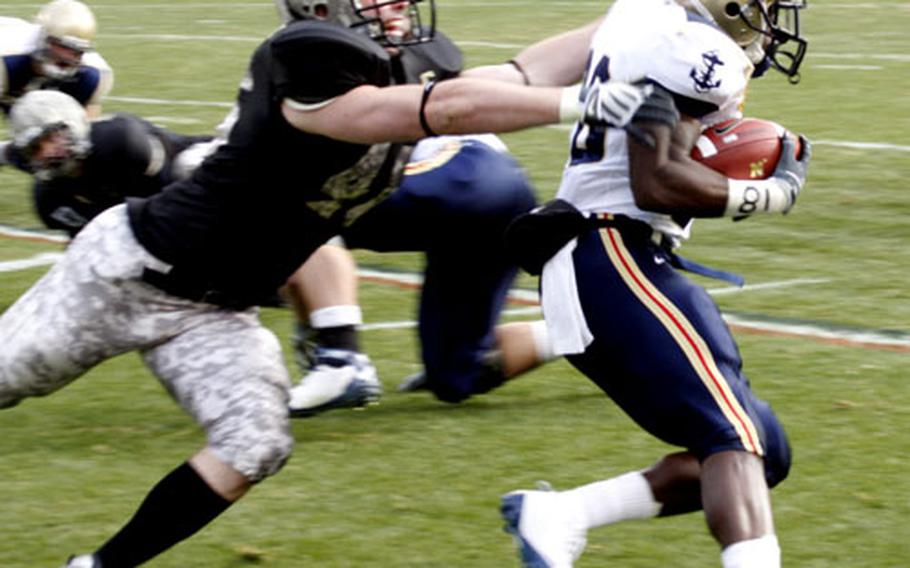 Navy's Shun White tries to shake off an Army tackler as he picks up a few of his 147 yards during Saturday's game at Philadelphia. White scored two TDs in a 34-0 Navy rout.