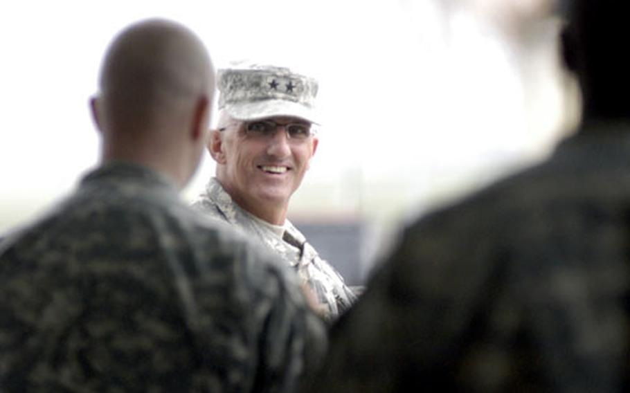 Maj. Gen. Mark P. Hertling waits outside a Wiesbaden gym along with 27 other soldiers who returned with him Wednesday from Iraq. The soldiers were in Iraq for 15 months.