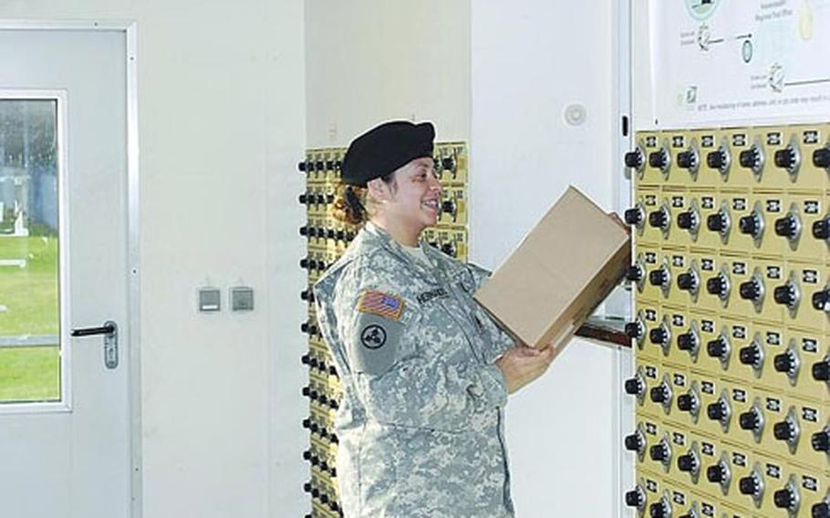Army Staff Sgt. Estela Hernandez with the 486th Movement Control Team picks up her mail at Daenner Kaserne in Kaiserslautern, Germany, on Monday.