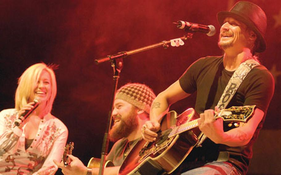 Kid Rock and Zac Brown smile through some botched lyrics during a song Tuesday.