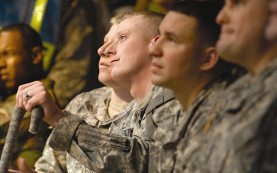 Army Spc. Kris Wynkoop takes in some of Kid Rock's acoustic grooves during the show.