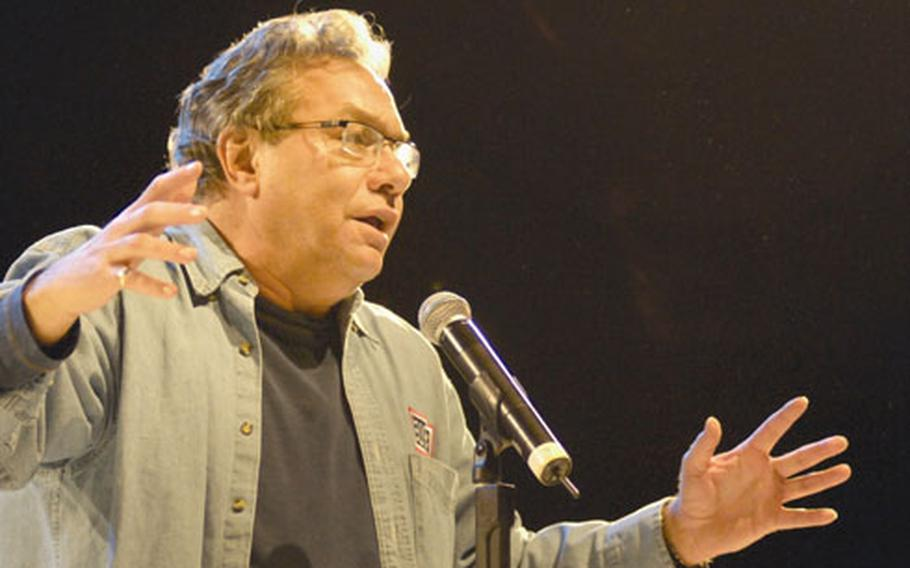 Comedian Lewis Black rants through a bit on gas and the economy during a show Tuesday at Ramstein Air Base's Hanger 1.