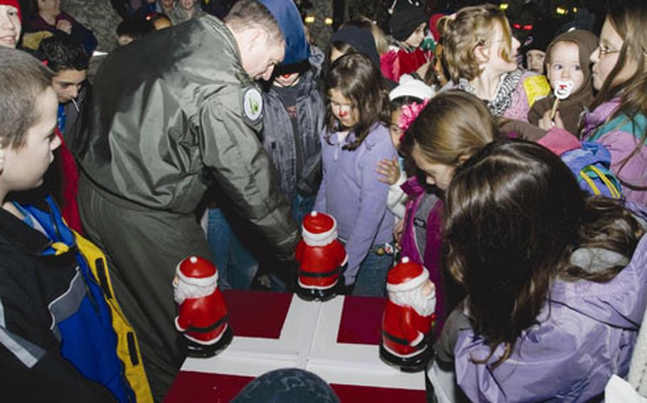 Col. Jay Silveria, commander of the 48th Fighter Wing, helps children turn on the Christmas tree during a lighting ceremony Dec. 5 at RAF Lakenheath.