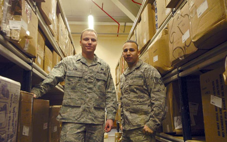 Staff Sgts. Aaron Kain, left, and Darian Lira of the RAF Mildenhall post office.